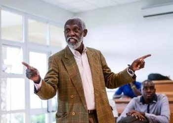 Who holds the university Prof Adei accountable for the kind of graduates produced?