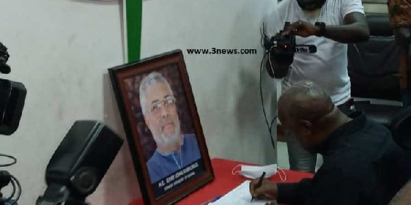Mahama signing the book of condolence opened in honour of Rawlings at the party headquarters